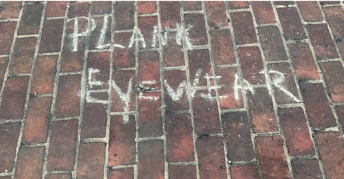 PLANK Eyewear written in chalk on sidewalk